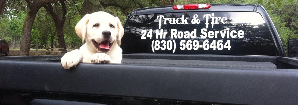 24-hour roadside truck with Labrador puppy